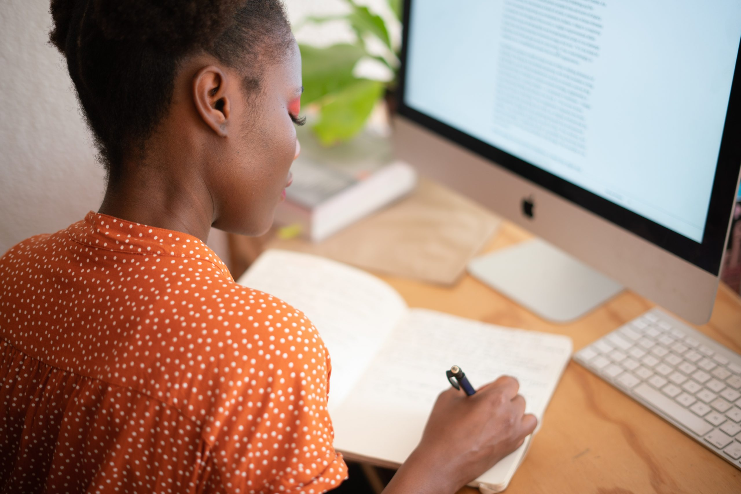 woman-writing-on-her-notebook-work-from-home-scaled.jpg